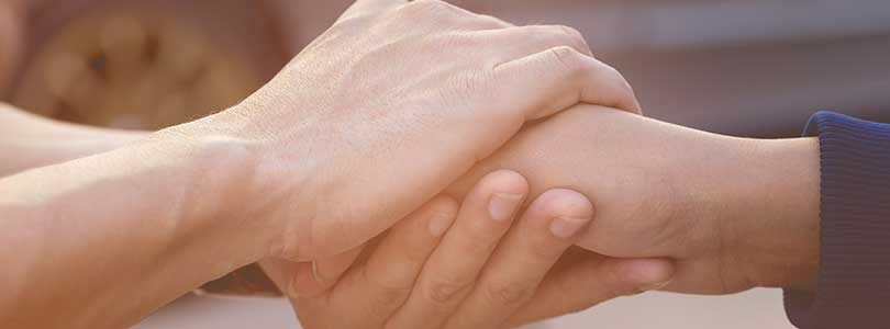 a_photo_of_people_holding_hands_supporting_each_other