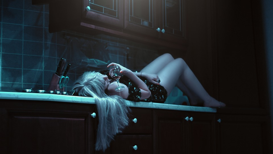 image of a woman drinking alcohol at her dark kitchen