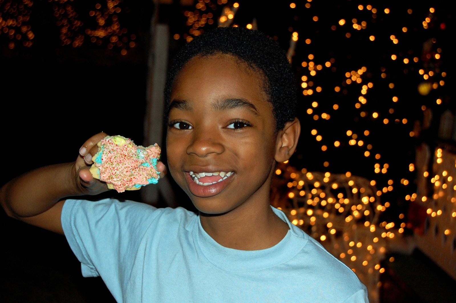 a-young-boy-enjoying-some-sweets-image