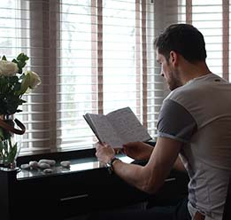 Man Reading Book At Desk